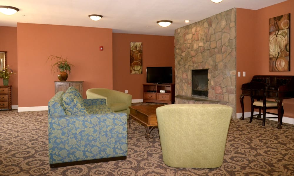 Sitting area with fireplace at Wheatfields Senior Living Community in Clovis, New Mexico