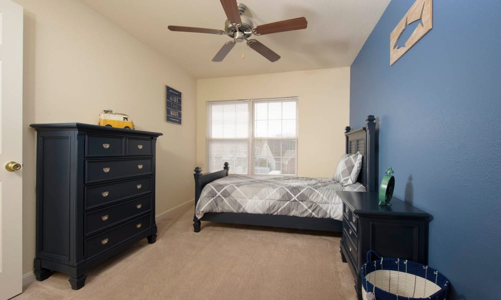 Bedroom with ceiling fan at Villas at Greenview West in Great Mills, Maryland