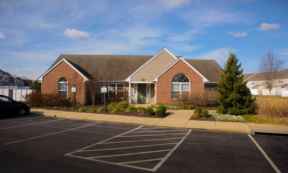 Facade with ample parking at Villas at Greenview West in Great Mills, Maryland