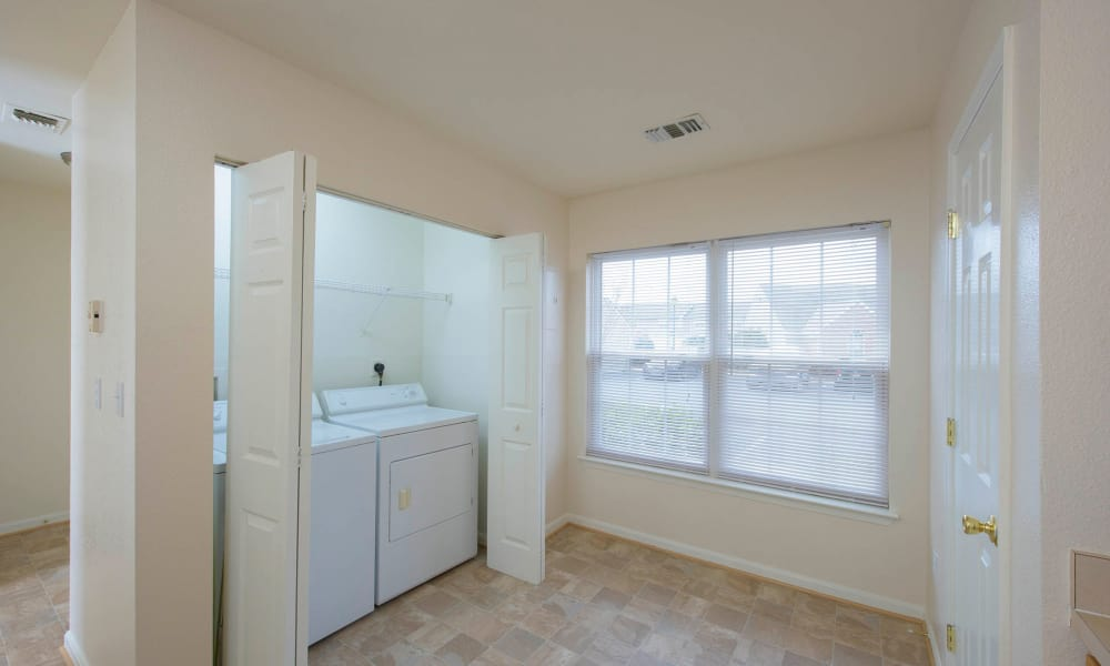 Laundry room with washer and dryer in unit at Villas at Greenview West in Great Mills, Maryland