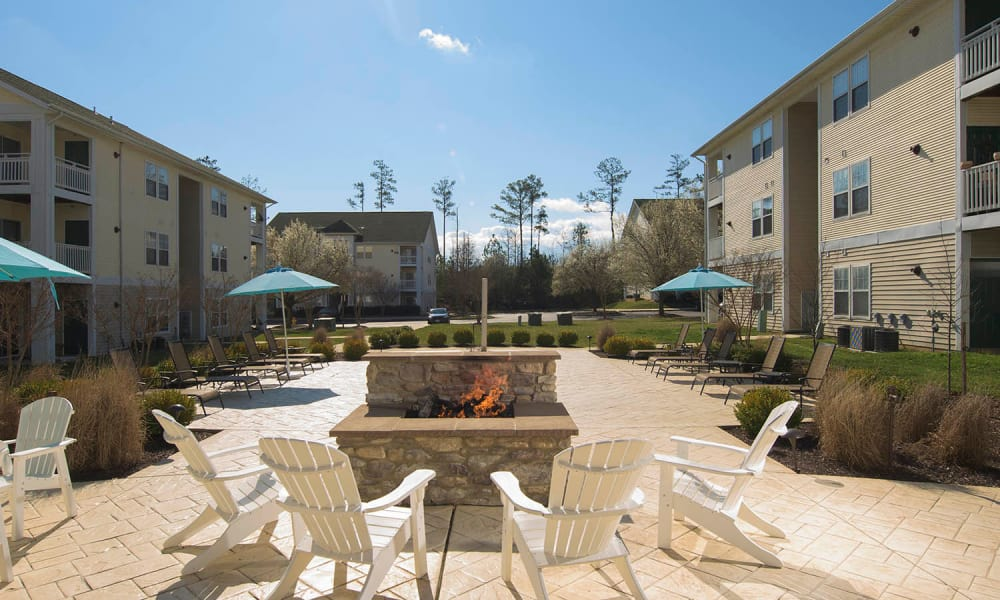 Beautiful Courtyard with fire pit and shaded seating at Park Villas Apartments in Lexington Park, Maryland
