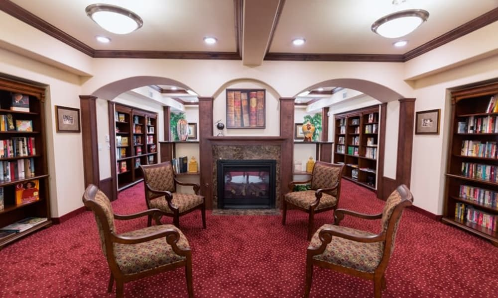Fireside seating in the library at Julian Estates Gracious Retirement Living in Puyallup, Washington