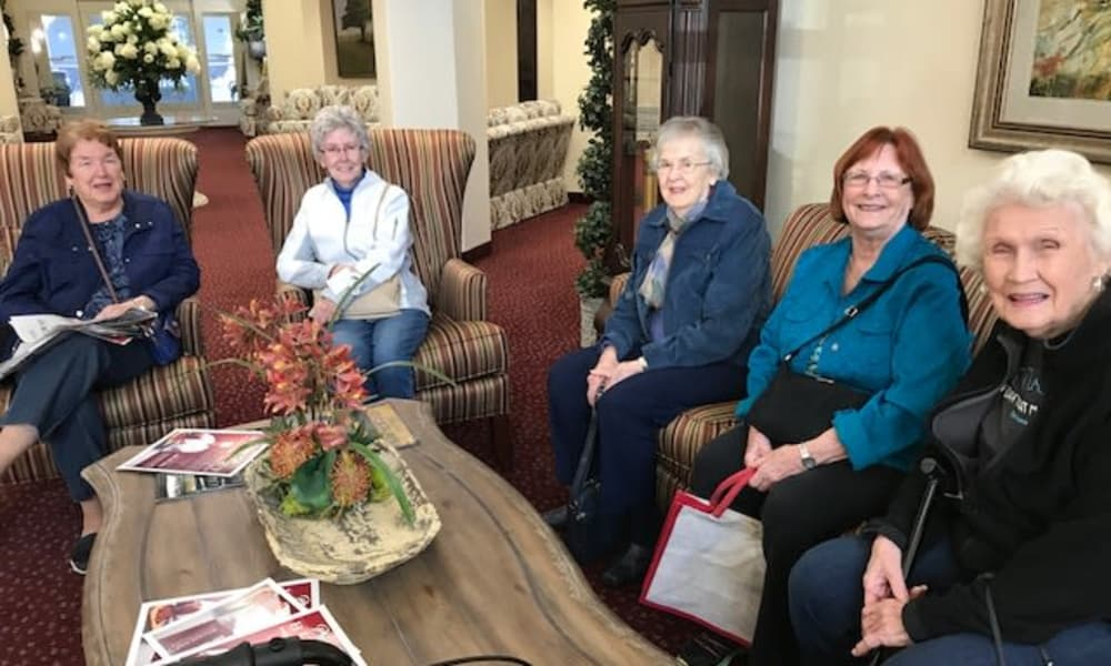 A group of residents sitting in the lounge at Linwood Estates Gracious Retirement Living in Lawrenceville, Georgia