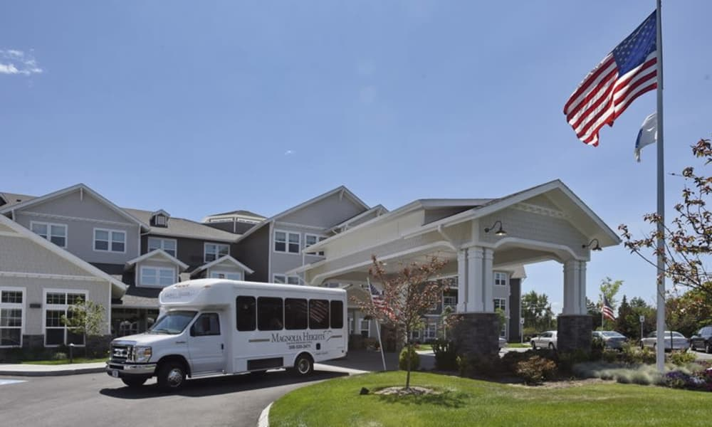 The community bus in front of Magnolia Heights Gracious Retirement Living in Franklin, Massachusetts