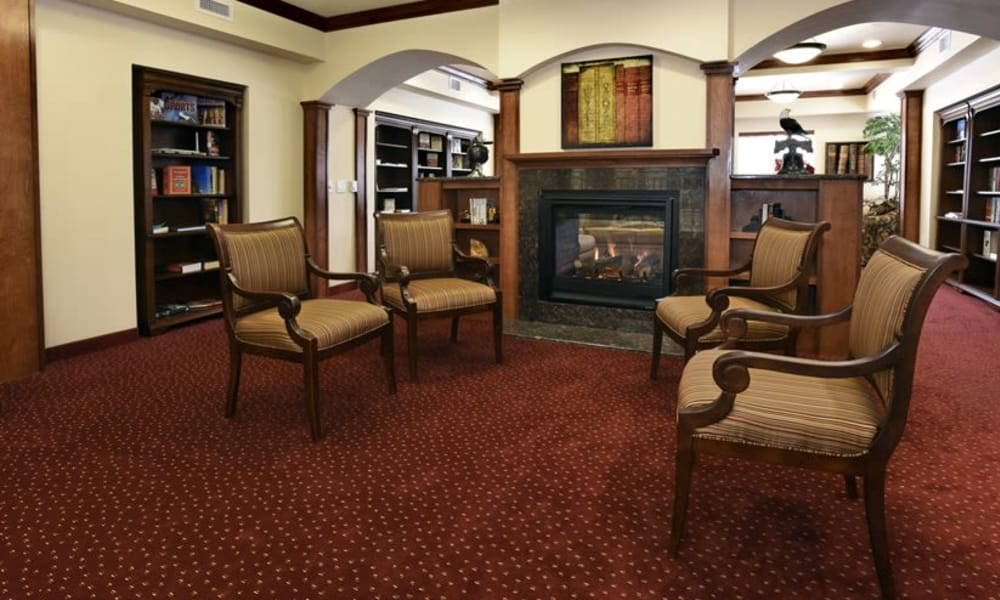 Fireside seating in the library at Magnolia Heights Gracious Retirement Living in Franklin, Massachusetts