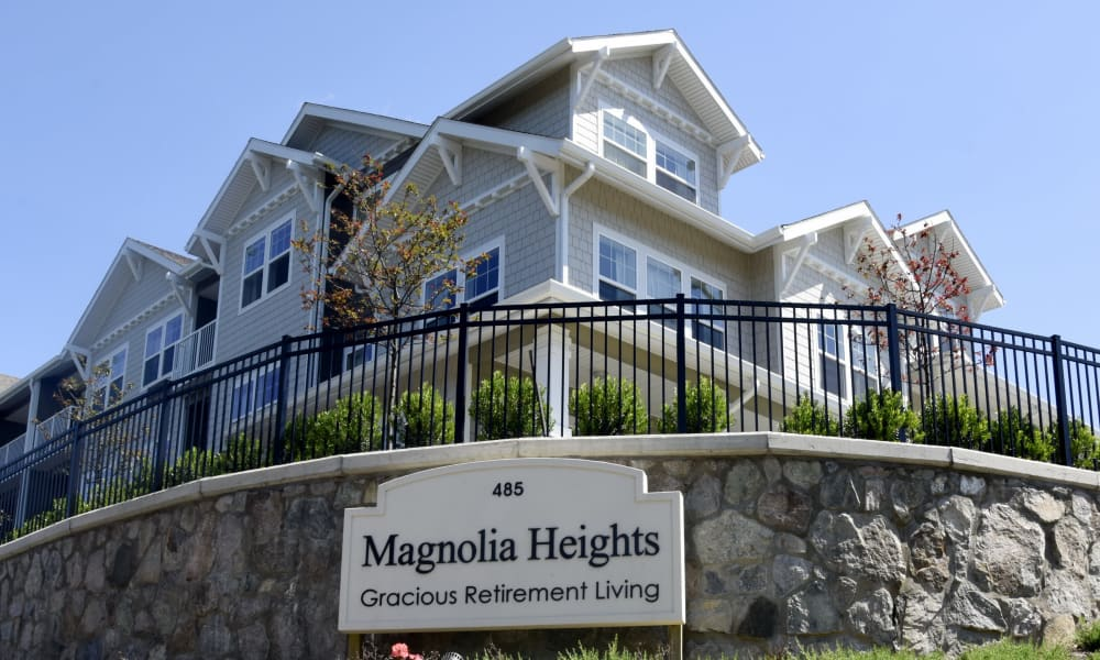 Branding and signage outside Magnolia Heights Gracious Retirement Living in Franklin, Massachusetts