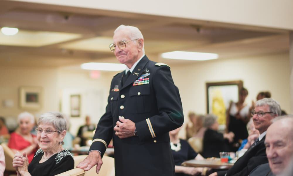 A veteran resident being recognized at Meadowlark Estates Gracious Retirement Living in Lawrence, Kansas