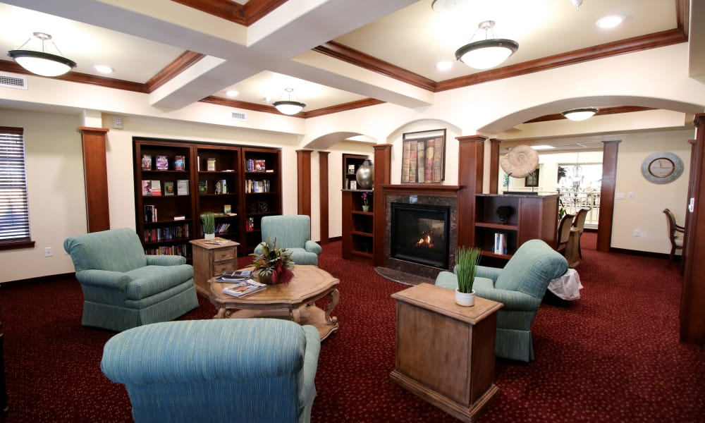 Fireside seating in the library at Mulligan Park Gracious Retirement Living in Tallahassee, Florida