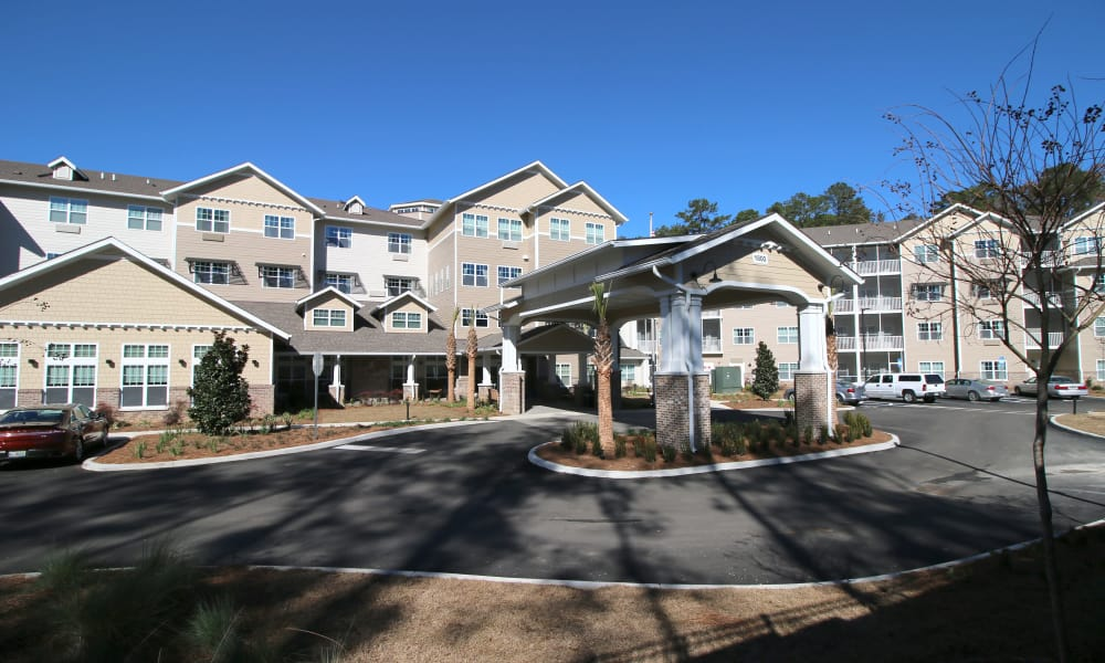 Building exterior and main entrance at Mulligan Park Gracious Retirement Living in Tallahassee, Florida