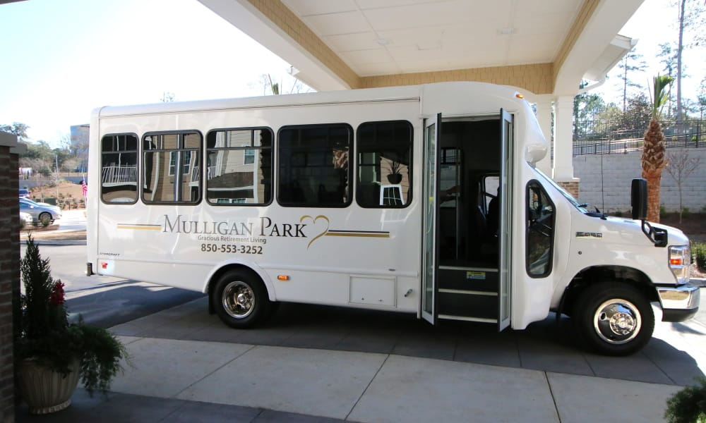 The community bus parked in front of Mulligan Park Gracious Retirement Living in Tallahassee, Florida