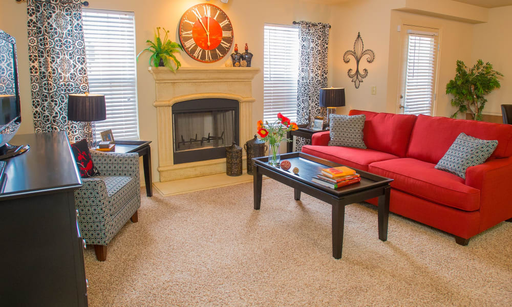 Living room with fireplace at Coffee Creek Apartments in Owasso, Oklahoma