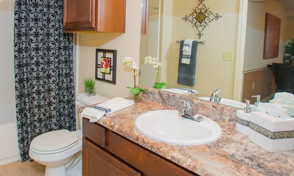 Bright bathroom at Coffee Creek Apartments in Owasso, Oklahoma