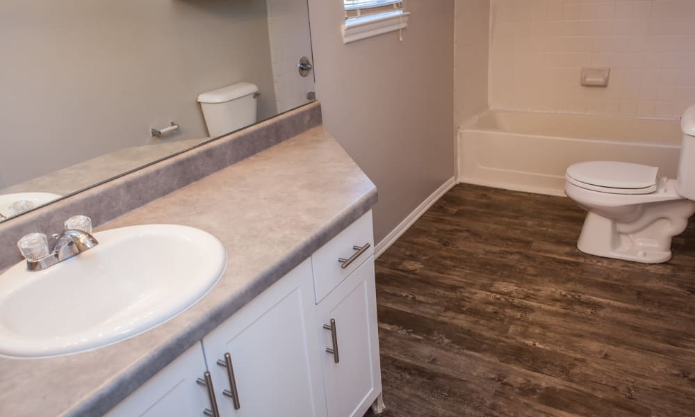 Bathroom with hardwood floors at Signature Place in West Des Moines, Iowa