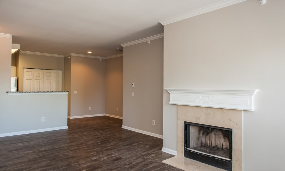 Living room with a fireplace and hardwood floors at Signature Place in West Des Moines, Iowa