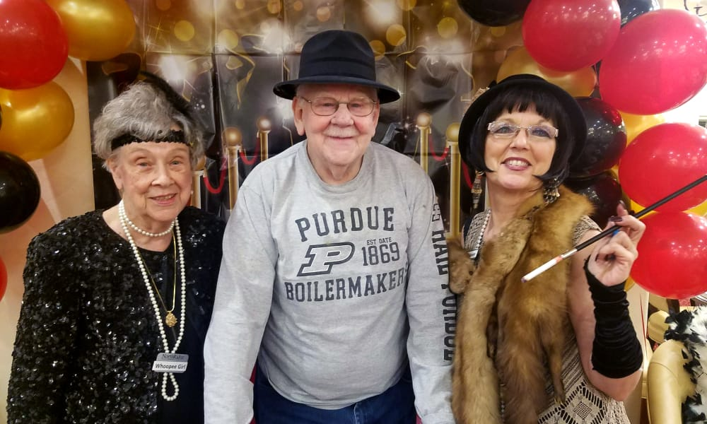 Residents dressed for a sixties themed day at Northridge Gracious Retirement Living in Fishers, Indiana