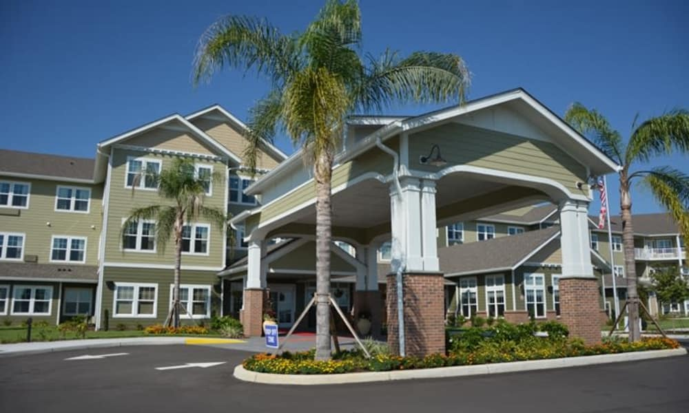 Building exterior and main entrance at Orchard Heights Gracious Retirement Living in Clermont, Florida