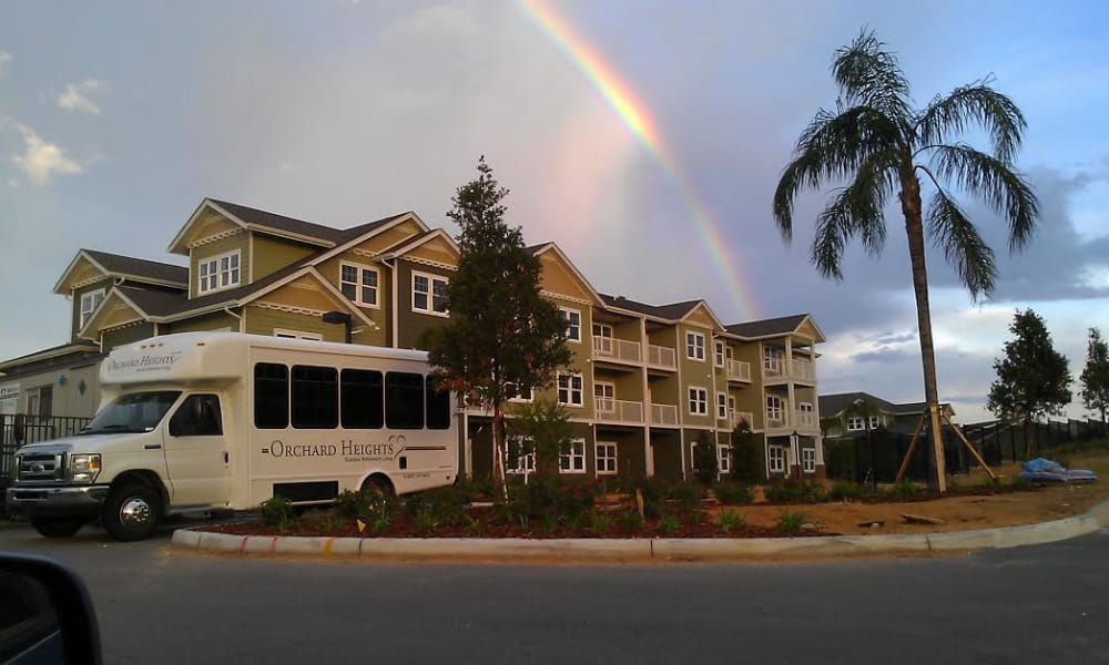 Community bus parked in front of Orchard Heights Gracious Retirement Living in Clermont, Florida