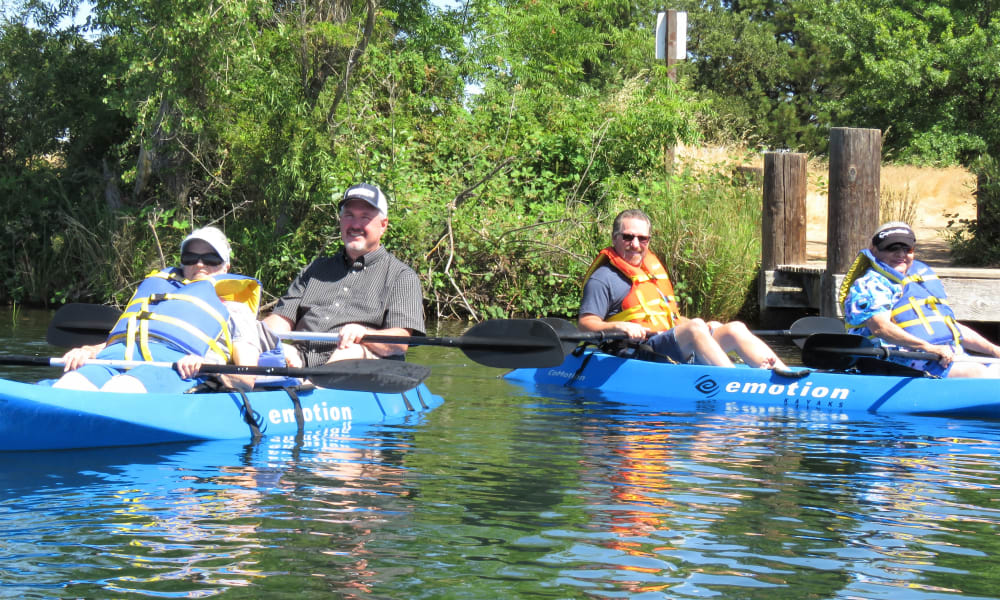 Smiling residents from Orchard Heights Gracious Retirement Living in Clermont, Florida in kayaks