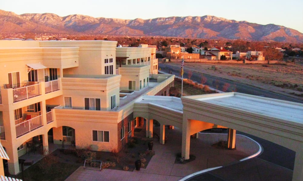 Building exterior and main entrance at Paloma Landing Retirement Community in Albuquerque, New Mexico