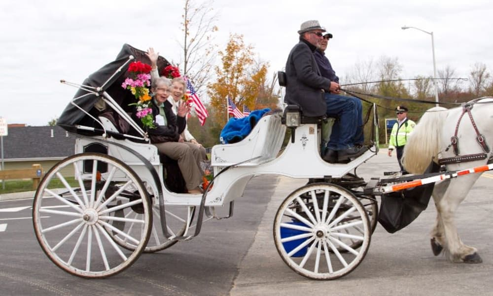 Two excited residents from Paloma Landing Retirement Community in Albuquerque, New Mexico in a horse drawn carriage