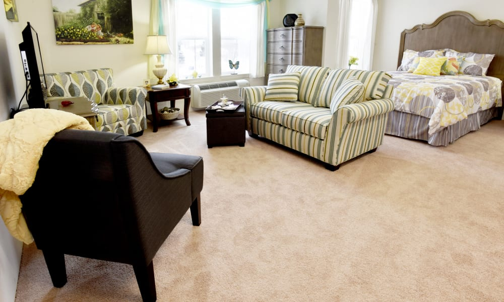 Living room of a senior living apartment at Pioneer Ridge Gracious Retirement Living in McKinney, Texas