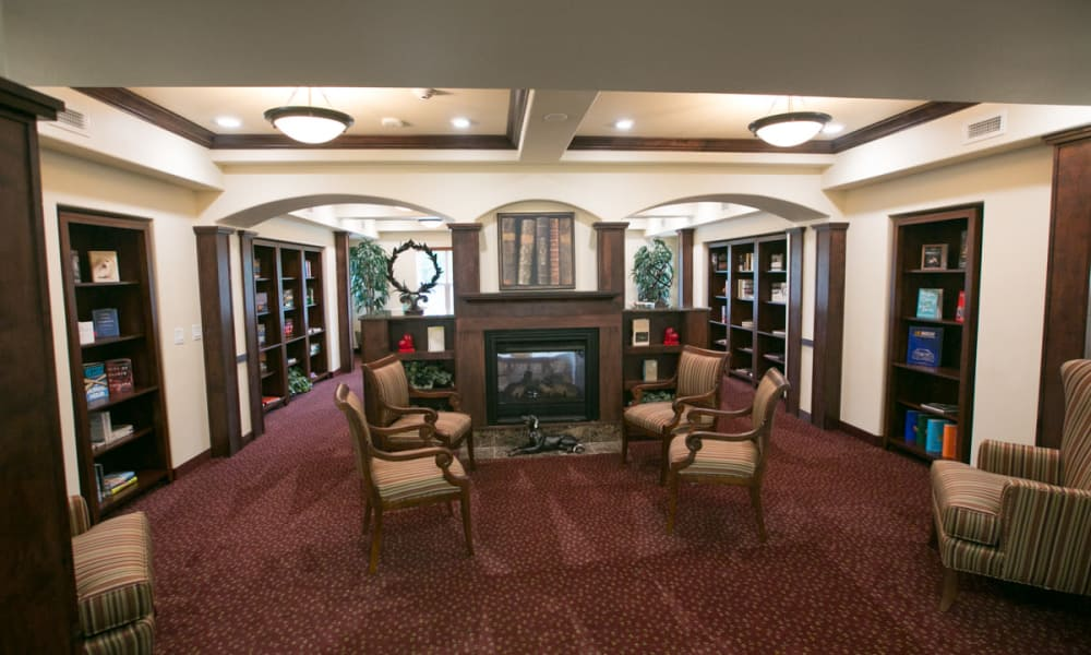 Fireside seating in the library at Providence Meadows Gracious Retirement Living in Charlotte, North Carolina