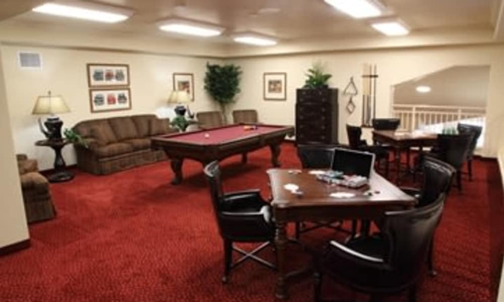 Game room with a billiards table at Salishan Gracious Retirement Living in Spring Hill, Florida