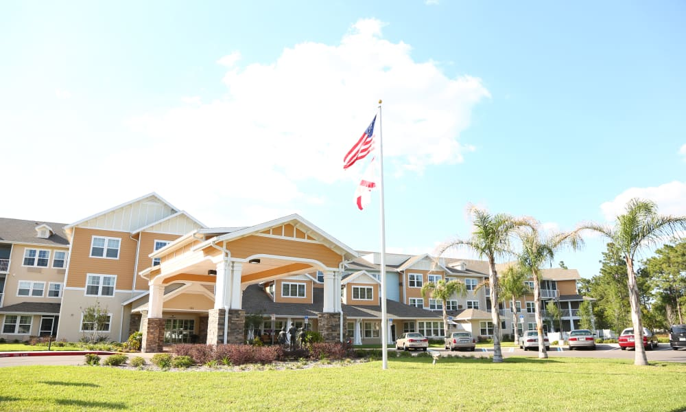 Building exterior and main entrance at Salishan Gracious Retirement Living in Spring Hill, Florida