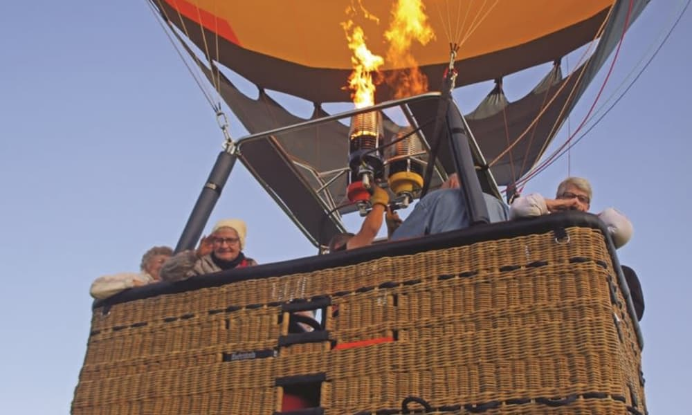 A group of happy residents from Salmon Creek in Boise, Idaho in a hot air balloon