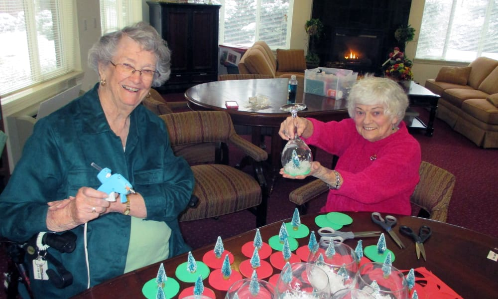 Two residents making holiday decorations for cups at Salmon Creek in Boise, Idaho