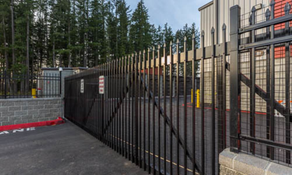 Secure gated entrance at Raceway Heated Storage - Covington in Covington, Washington