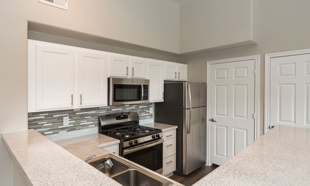 Upgraded kitchen with gas stovetop at Resort at University Park in Colorado Springs, Colorado