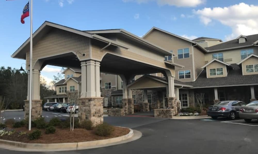 Building exterior and main entrance at Sanford Estates Gracious Retirement Living in Roswell, Georgia