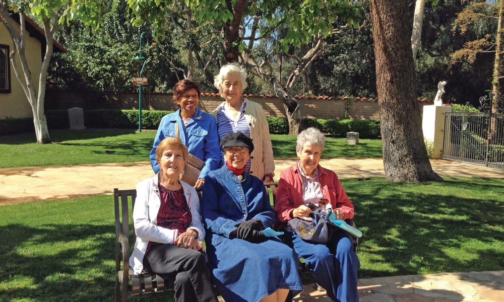 Residents sitting in the backyard at Scholl Canyon Estates in Glendale, California