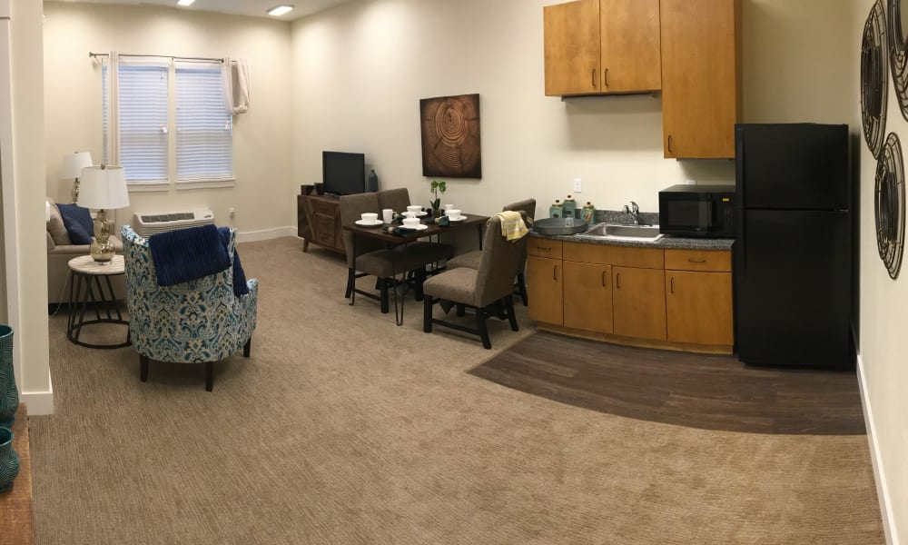 Model kitchen and dining area at Pear Valley Senior Living
