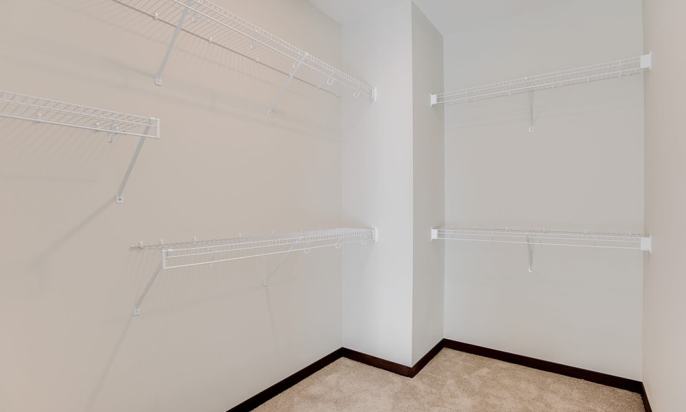 Walk-in closets with built-in shelving at Crossroads at Elm Creek