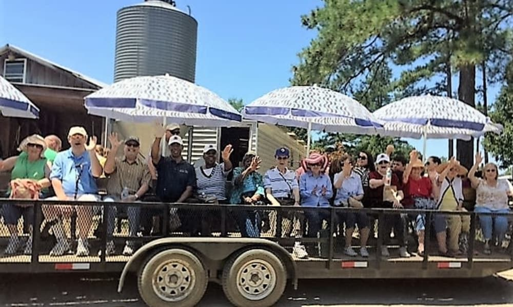 Residents from Southern Pines Gracious Retirement Living in Southern Pines, North Carolina sitting on a trailer during a parade