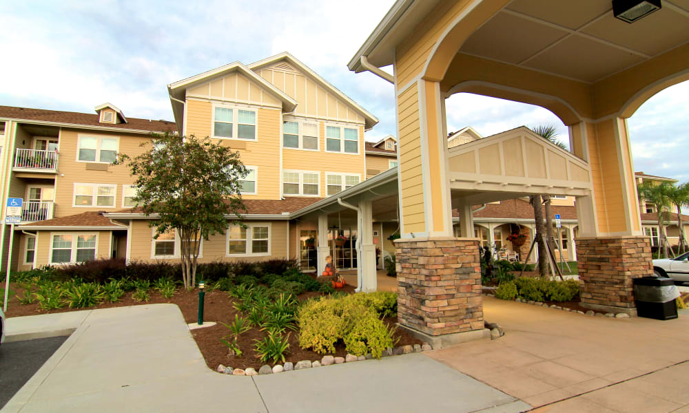 Building exterior and main entrance at Steeplechase Retirement Residence in Oxford, Florida