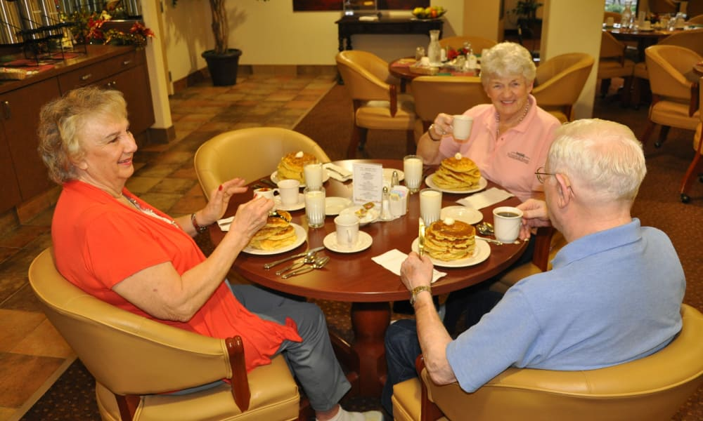Three residents having breakfast together at Steeplechase Retirement Residence in Oxford, Florida