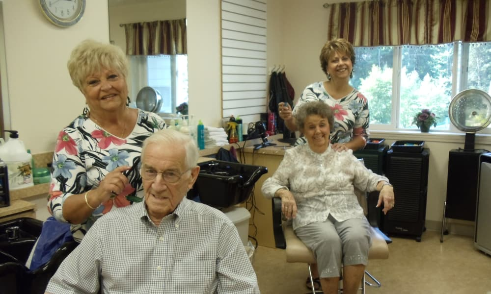 Two residents getting their hair cut at Sterling Heights Gracious Retirement Living in Bethlehem, Pennsylvania