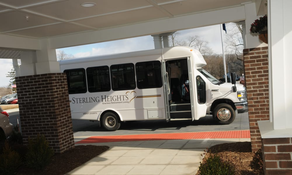 A resident getting on the community bus at Sterling Heights Gracious Retirement Living in Bethlehem, Pennsylvania