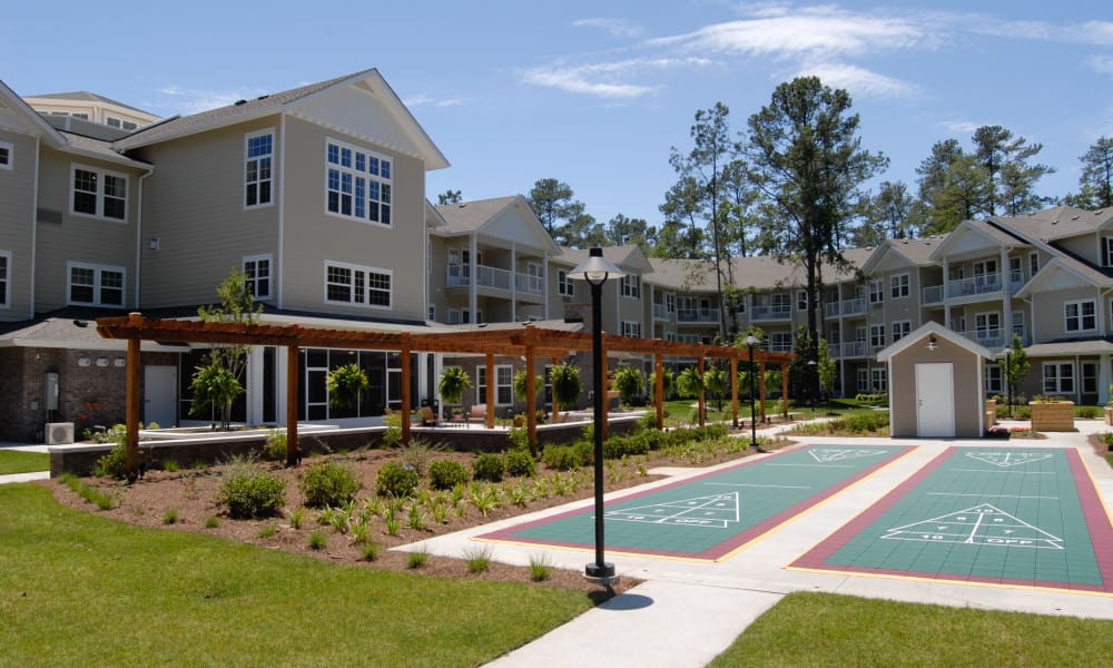Outdoor shuffleboard for residents at Summerville Estates Gracious Retirement Living in Summerville, South Carolina