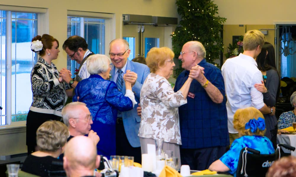 Residents dancing with each other at Summit Glen in Colorado Springs, Colorado