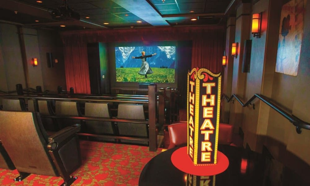 The onsite movie theater for residents at The Carriage House Gracious Retirement Living in Oxford, Florida