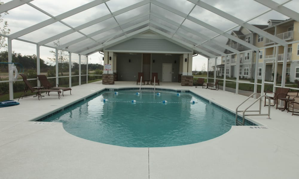 An indoor pool for residents at The Carriage House Gracious Retirement Living in Oxford, Florida