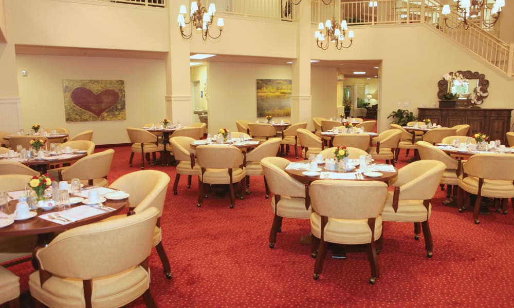 The community dining room for residents at The Carriage House Gracious Retirement Living in Oxford, Florida