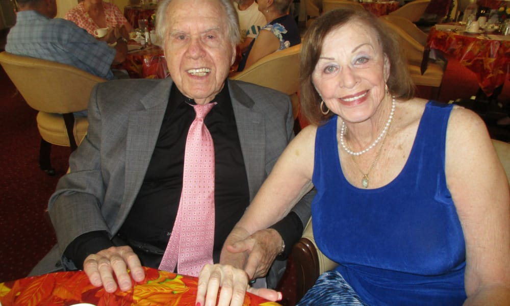 A couple posing for a photo at The Carriage House Gracious Retirement Living in Oxford, Florida