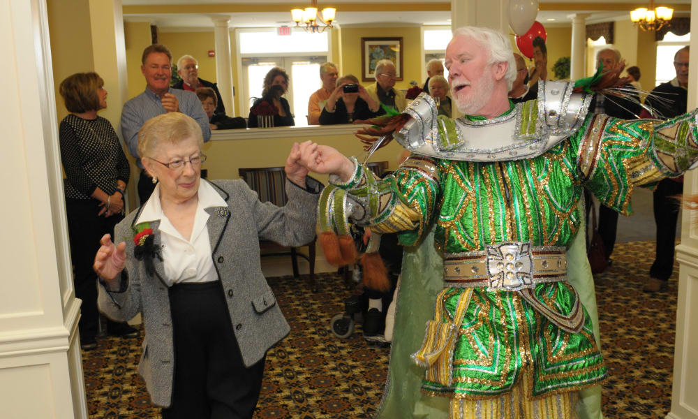 Two residents dancing together at The Birches at Newtown in Newtown, Pennsylvania