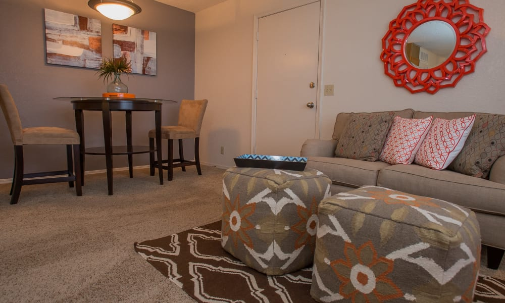 An apartment living room and dining room at Tammaron Village Apartments in Oklahoma City, OK