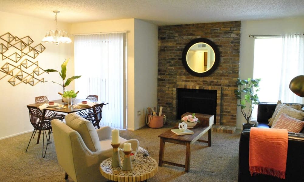 An apartment living room with fireplace at The Chimneys Apartments in El Paso, Texas